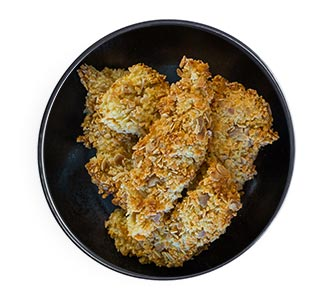 A bowl of almond-crusted chicken strips.
