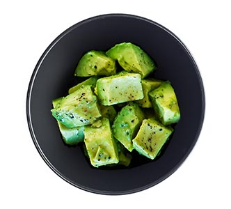 A bowl of citrus marinated avocado.