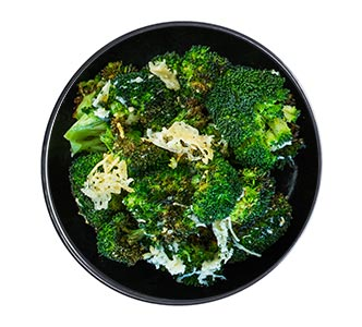 A bowl of parmesan-roasted broccoli.