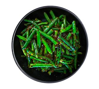 A bowl of dark green Szechaun green beans.