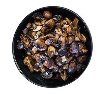 A bowl of wok-seared cremini mushrooms.